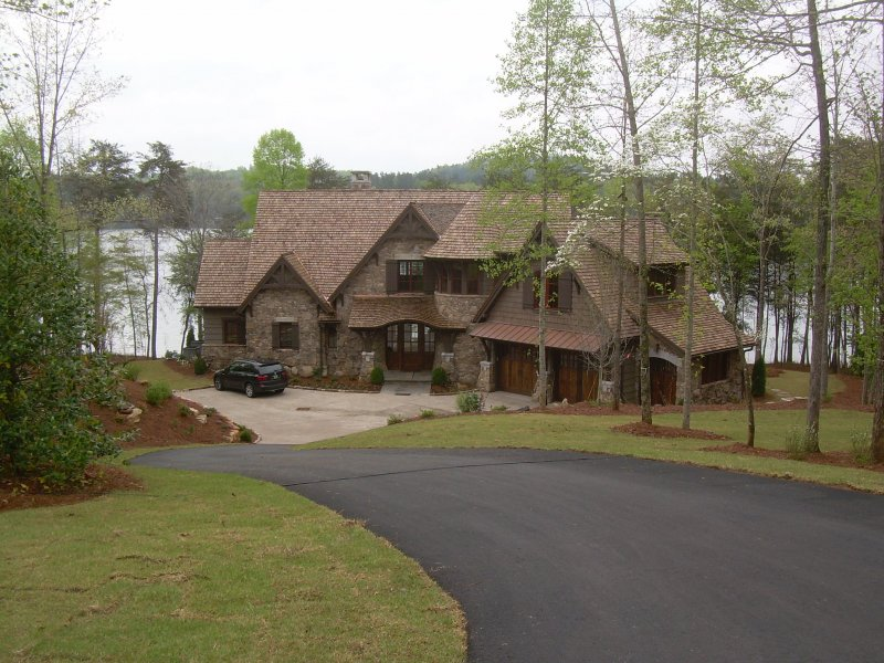 Under construction lakefront luxury home at the reserve for Lake keowee house plans