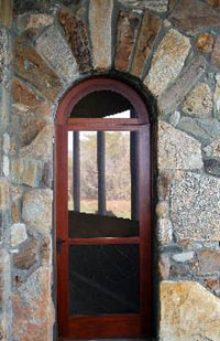 Carver Group's custom arched wooden and rock doorway
