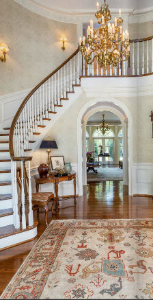 Greenville SC home custom curving staircase by Carver Group luxury homebuilder